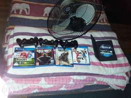Ps4 wit 3 remotes and 5 games