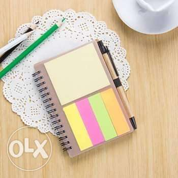 Note book with sticky notes and Pen