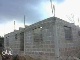 Uncompleted four flats for sale located at Benin Airport road