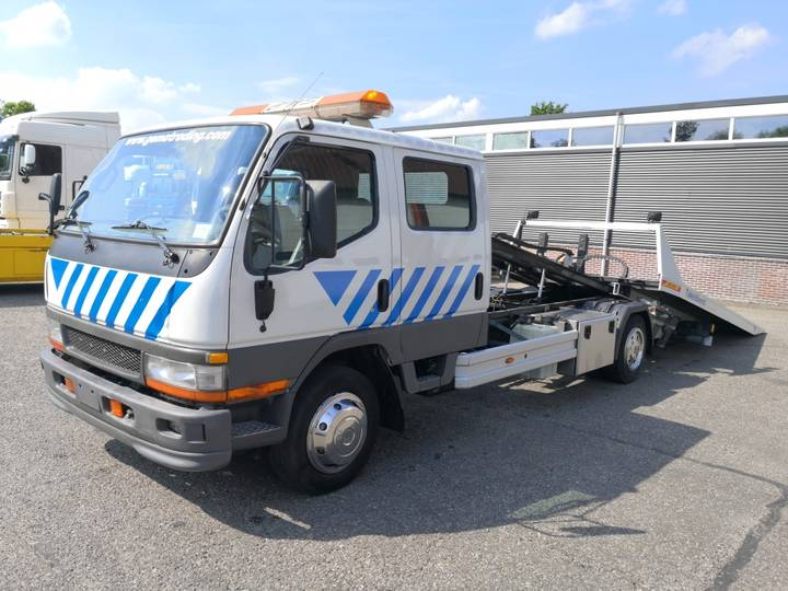 Mitsubishi Canter 7500kg 9 persoons Jige Rollmatic 35 - 2009