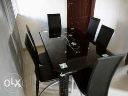 Exquisite Six Sitter Glass Dining Table and Chairs (New)