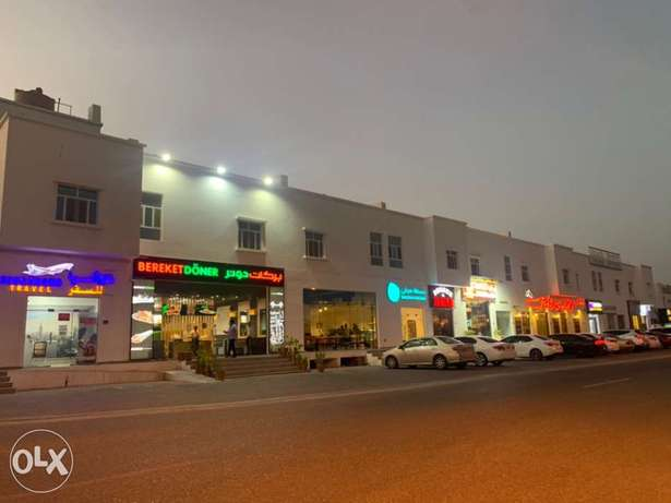 Shops in Al Khoudh main Street next to high brand cafes and restaurant