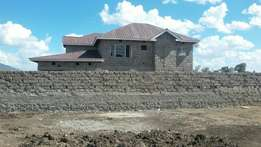 Prime plot for sale next to this hse within tka municipality