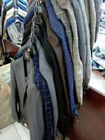 Brand new mens  suits imported from turkey free delivery within nairobi .