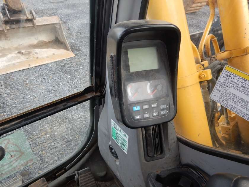 New Holland E135BSR-2 - 2009 - image 57