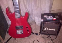 sunny electric guitar with amp and extras