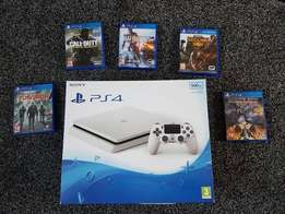 NEW Ps4 slim 500Gb in white with 5 games