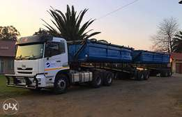 Nissan UD 460 with twin side tipper trailer