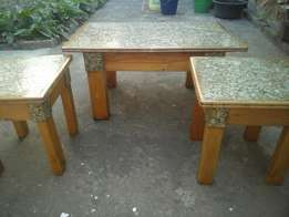 nicely made coffee table plus two stools for you