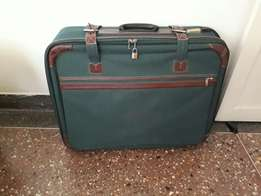 Imported suitcases with leather details for sale