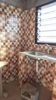 Cool brand new chamber & hall self contained for rent off Obom road