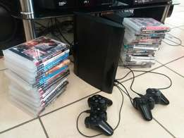 PS3 + 2 controls and 25 games