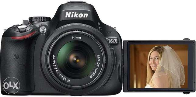 Nikon D5100 with 18-55mm & 70-300mm lenses