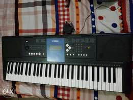New YAMAHA PSR E333 for quick sale (with pedal and adapter)