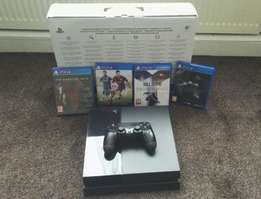 full sealed bundle bn PS4 1tb, 2 Black Controller, 4 games