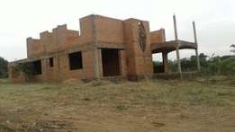 A residential building for sale after Kyaliwajjala in mulawa