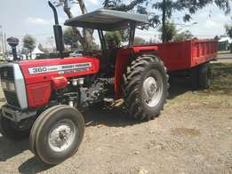 MF 360,with a 10 ton tipping trailer,and free disc plough.
