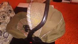 Slightly used Carry Cot infant car seat it rocks
