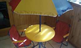 Selling a child's table and chairs and umbrella make an offer