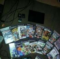 PS2 PlayStation for sale + 18 games.