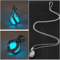 glow in the dark stone like pendant with chain . glows blue