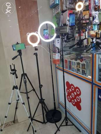 Tripods with selfie light for TikTok and makeup videos.