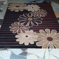 Brown floral design center rug. 5x7