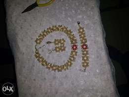 Beaded necklace, bracelet and earrings.