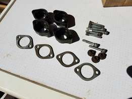 Injector spacers and clamps for nissan