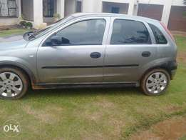 silver grey opel corsa with 4doors 1,6