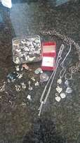 Costume jewelry and stainless steel rotation rings up for sale