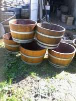 Half French oak wine barrel planters.