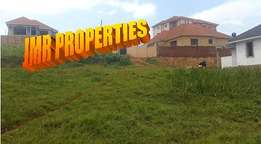Sure deal 50 by 100ft plot for sale in Kyanja trading centre at 65m