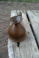 Antique measuring jug