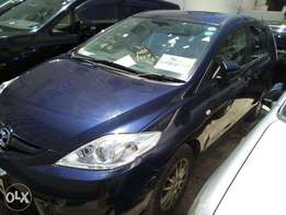 Blue Mazda premacy 2010 car on sale.
