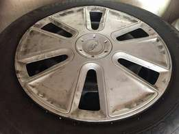 14 inch rims with wheel caps all rims good wheels caps one in not to b