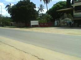 Prime plot in Diani on Tarmac next to co-operative bank.