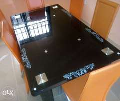 Top class six seater glass dining table