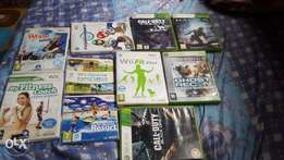 Xbox 360 S and Nintendo Wii consoles and cds both for sale
