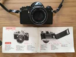 Pentax ME 1000 35mm DSLR camera with accessories.
