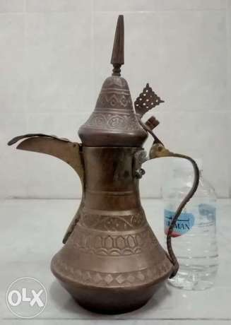An ancient inscribed traditional dallah