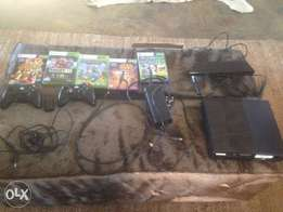 Xbox (Kinect camera, HDMI cable, 2 remotes, extra charger kit, 5 games