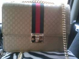 Gucci leather gold purse bag