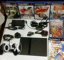 ps2 playstation 2 slimline console includes games