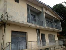 One story building at Gowon Estate with two shops underneath