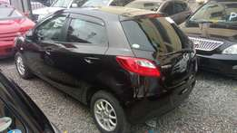 Mazda verisa winered n white 2010