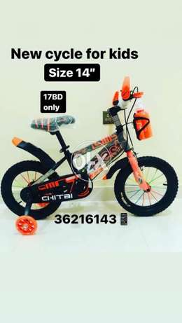 """New cycle for kids orange color LED lights on the side tier size 14"""""""