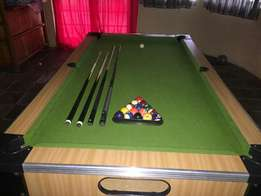 Pool table with cue's and balls