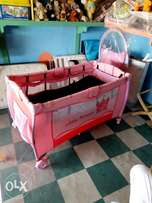 Pink UK neatly used baby cot/playpen(just like new)