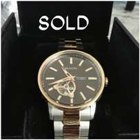 Boluva mechanical fully automatic watch new in box, retail 18k.